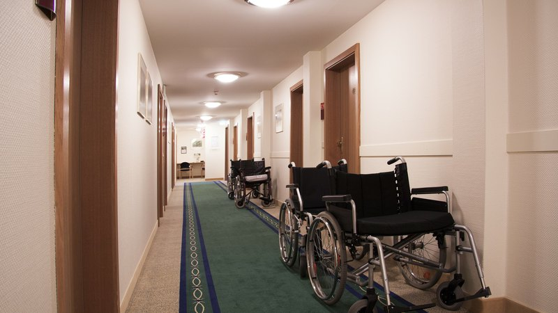 picture taken at a nursing home corridor with an administrator desc